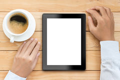 Business man using tablet white display with coffee drink Stock Photography