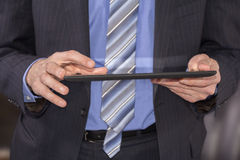Business man using tablet Stock Photo