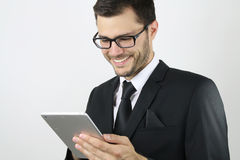 Business man using a touch pad Royalty Free Stock Images