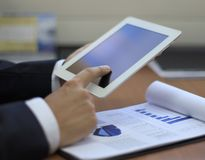 Business man using a touch pad Stock Images