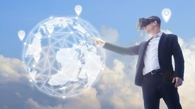 Business man using VR headset and interacting with object world. A business man using VR headset and interacting with object world display.man getting experience Royalty Free Stock Images
