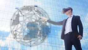 Business man using VR headset and interacting with object world. A business man using VR headset and interacting with object world display.man getting experience Stock Image