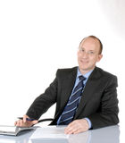 Business man V. Isolated, smiling business man sitting behind a desk stock photo