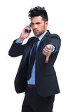 Business man with very bad news on the phone Royalty Free Stock Image