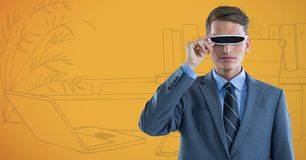 Business man in virtual reality headset against yellow hand drawn office. Digital composite of Business man in virtual reality headset against yellow hand drawn Stock Images