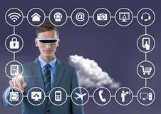Business man with vr glasses touching digitally generated connecting icons Royalty Free Stock Photo