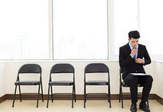 Business man waiting for job interview. Young business man waiting for job interview Royalty Free Stock Image