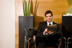 Business man waiting in office lobby Stock Photography