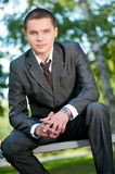 Business man waiting at park. Student Royalty Free Stock Photography