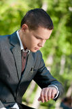 Business man waiting at park. Watch. Student Stock Images