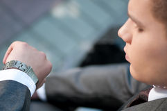 Business man waiting at park. Watch. Student Stock Photography