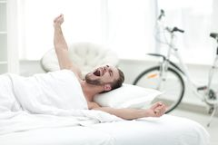 Business man waking up on Sunday morning. Photo with copy space Royalty Free Stock Image