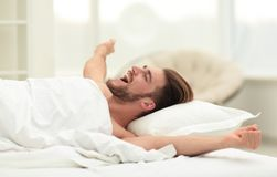 Business man waking up on Sunday morning. Photo with copy space Royalty Free Stock Photos