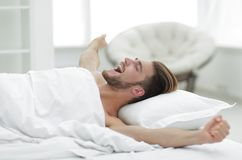 Business man waking up on Sunday morning. Photo with copy space Royalty Free Stock Images