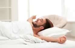 Business man waking up on Sunday morning. Photo with copy space Stock Photography