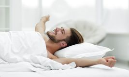 Business man waking up on Sunday morning. Photo with copy space Stock Photos