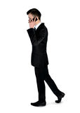 Business man walk with phone Royalty Free Stock Image