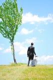 Business man walking Stock Images