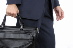 Business man walking with briefcase Stock Photos