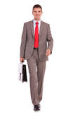 Business man is walking with a briefcase Stock Photography