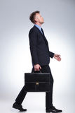 Business man walking with briefcase Stock Photo