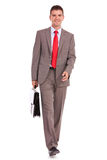 Business man walking and carrying suitcase Stock Photography