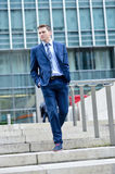 Business Man Walking Down Some Steps Stock Photography