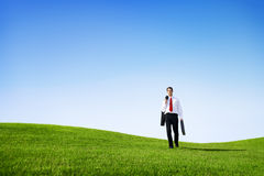 Business Man Walking in the Field Royalty Free Stock Photos