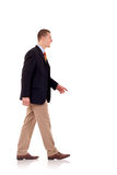 Business man walking forward Stock Images