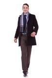 Business man walking forward Stock Images