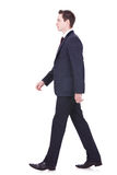 Business man walking forward Royalty Free Stock Photo