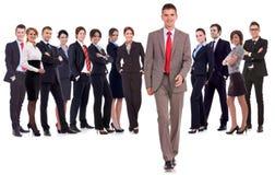 Business man walking forward leading team stock photo
