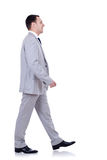 Business man walking forward - side view Royalty Free Stock Photography