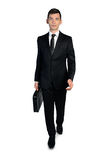 Business man walking front Stock Photos