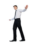 Business man walking on imaginary rope Royalty Free Stock Image