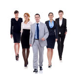 Business man walking and leading his team Stock Photo