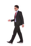 Business man walking and looking away Stock Photos