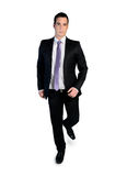 Business man walking looking camera Royalty Free Stock Images