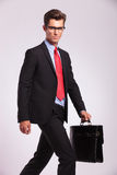 Business man walking & looking at you Royalty Free Stock Photography
