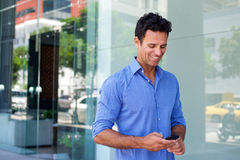 Business man walking with mobile phone Royalty Free Stock Photography