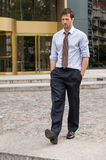 Business man walking out of the office Stock Images