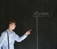 Business man and chalk success street sign Stock Photos