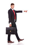 Business man walking & pointing Stock Photo