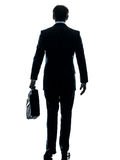 Business man walking rear view silhouette Royalty Free Stock Image