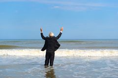 Business man walking in the sea royalty free stock photos