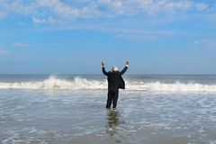 Business man walking in the sea stock photography