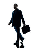 Business man walking silhouette isolated. One caucasian business man walking  silhouette isolated on white background Stock Photos
