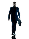 Business man walking silhouette isolated. One caucasian business man walking  silhouette isolated on white background Royalty Free Stock Photos