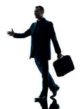 Business man walking silhouette isolated. One caucasian business man walking  silhouette isolated on white background Royalty Free Stock Photography