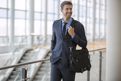 Business man walking with smile Royalty Free Stock Photo